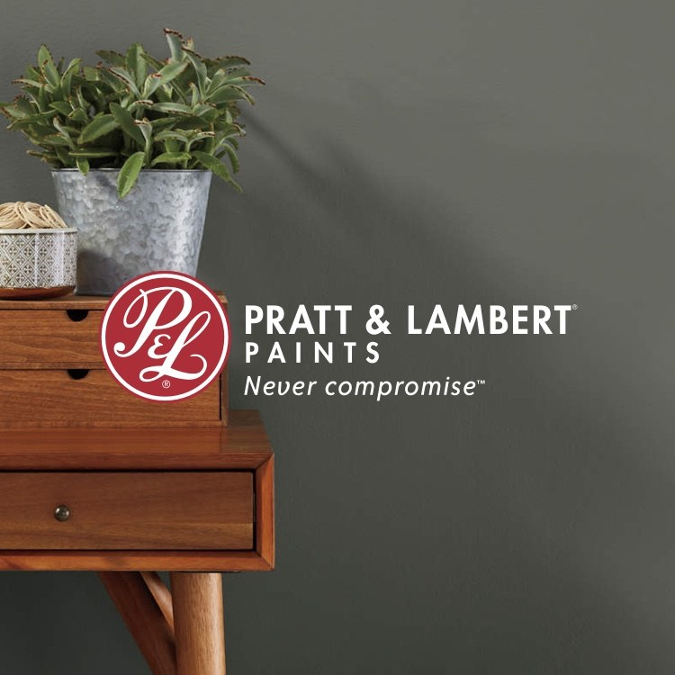 Pratt & Lambert painted room with desk and logo with slogan Never Compromise